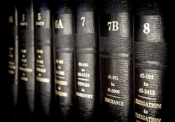 This image depicts books of law. Only a New Orleans Governmental Liability Lawyer can advise you of your rights against the government. Contact a New Orleans Government Liability Lawyer today to discuss a potential lawsuit against the government.