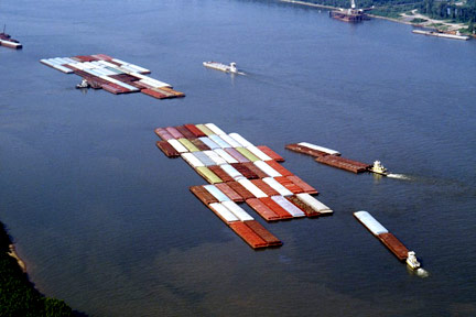 This is a fleet of barges like those that float up and down the Mississippi River. If you were injured on a barge near New Orleans or in Southeastern Louisiana, call a New Orleans Maritime Attorney today.